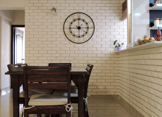 stone cladding wall with clock in dining area